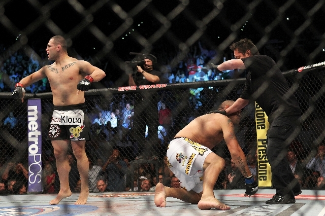 Cain Velasquez celebrates his first-round knockout of Antonio Silva as referee Mario Yamasaki signals the end of the heavyweight title bout Saturday in UFC 160 at the MGM Grand Garden.