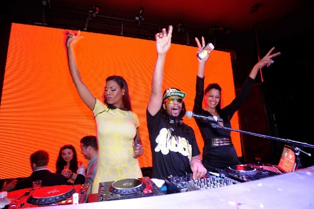 Lil Jon, flanked by Omarosa, left, and Claudia Jordan, performs at Surrender. Lil Jon will be back at the club Saturday, performing with Sidney Samson.