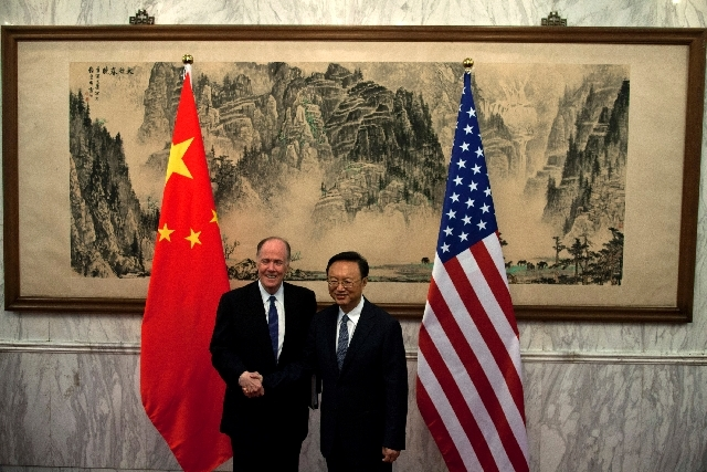 U.S. National Security Adviser Tom Donilon, left, and Chinese State Councilor Yang Jiechi shake hands before their meeting at Diaoyutai State Guesthouse in Beijing on Monday.