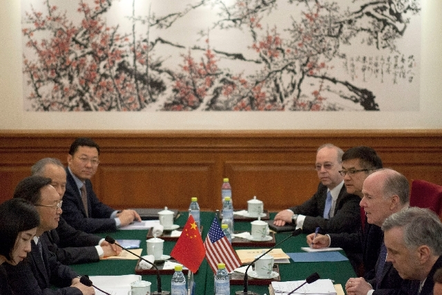 U.S. National Security Adviser Tom Donilon, second from right, and Chinese State Councilor Yang Jiechi, second from left, talk during their meeting at Diaoyutai State Guesthouse in Beijing on Monday.