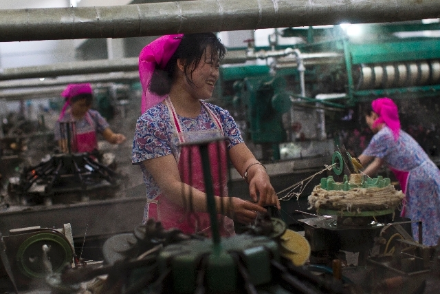 North Korean women work in a thread factory in Pyongyang, North Korea on Apr. 9, 2012.