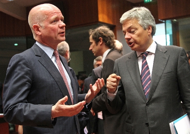British Foreign Secretary William Hague, left, talks with Belgium's Foreign Minister Didier Reynders, during the EU foreign ministers meeting, at the European Council building in Brussels on Monday.