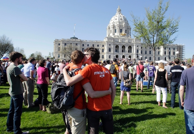 A crowd gathers at the State Capitol in St. Paul, where Minnesota Gov. Mark Dayton signed gay marriage into law on May 14.