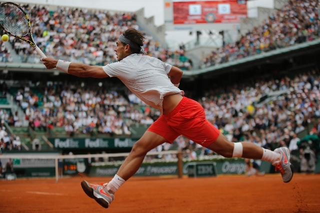 Spain's Rafael Nadal returns against Germany's Daniel Brands in their first round match at the French Open, at Roland Garros stadium in Paris on Monday.