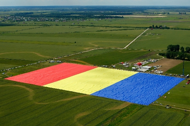 An aerial picture shows a huge Romanian flag on the Clinceni Airfield, south of Bucharest,  Romania, Monday. Romania entered the Guinness Book of records after it unveiled the largest flag ever made.