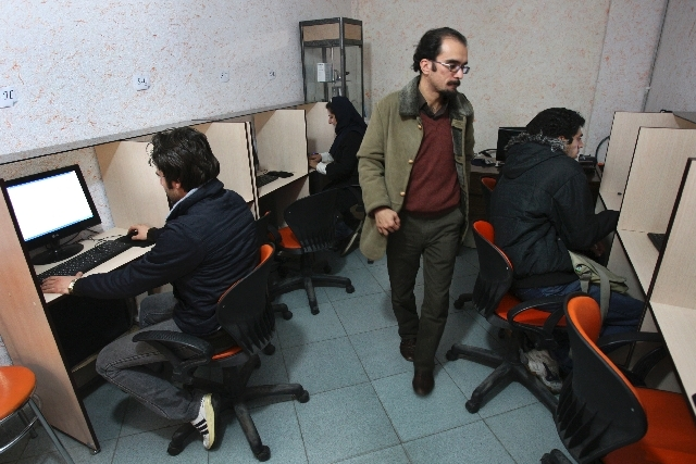 Iranians use the Internet in a local cafe in central Tehran, Iran on Jan. 18, 2011.