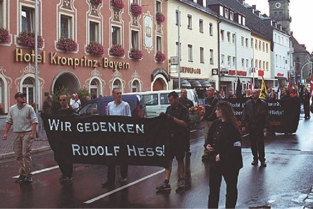Neo-Nazis are seen during a rally in memory of Adolf Hitler's deputy Rudolf Hess in Hess' Bavarian hometown of Wunsiedel, southern Germany on Aug. 17, 2002. The small town in Germany that was a pi ...