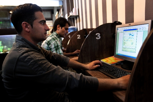 Iranians surf the web in an Internet cafe in central Tehran, Iran on Monday.