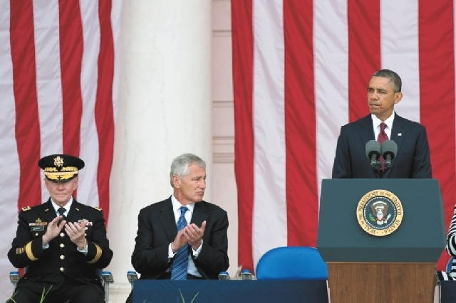 U.S. Secretary of Defense Chuck Hagel, center, and Chairman of the Joint Chiefs of Staff Gen. Martin Dempsey, left, applaud as President Barack Obama delivers his Memorial Day remarks Monday at Ar ...