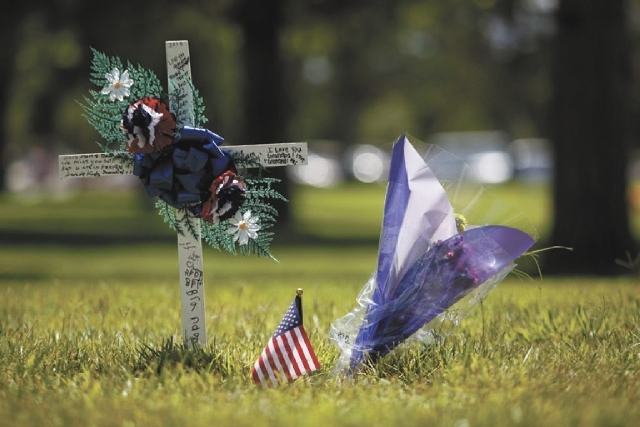 Decorations at the grave of U.S. Army PFC Philip M. Mincieli, who served in World War II, along with wife Laurettrecia, are seen at the Southern Nevada Veterans Memorial Cemetery in Boulder City o ...