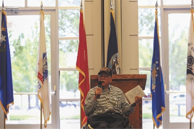 Keynote speaker World War II Navy veteran Charles Demos talks during the Retiring of Colors as part of the Memorial Day Ceremony at the Southern Nevada Veterans Memorial Cemetery in Boulder City o ...