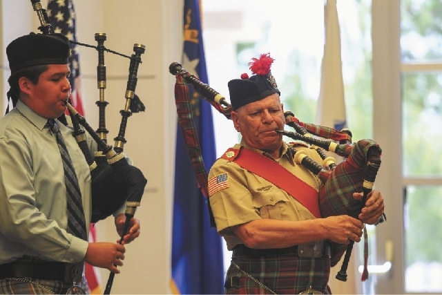 Scottish American Military Society, Post 777 pipers perform during the Retiring of Colors as part of the Memorial Day Ceremony at the Southern Nevada Veterans Memorial Cemetery in Boulder City on  ...