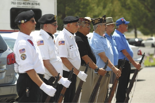 The Joint Firing Honor Guard stands after the 21 Gun Salute at the end of the Memorial Day Ceremony at the Southern Nevada Veterans Memorial Cemetery in Boulder City on Monday.