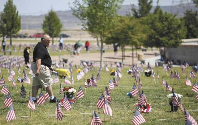 A man walks through the the Southern Nevada Veterans Memorial Cemetery in Boulder City on Monday.