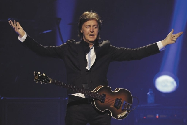 """In this Saturday, May 18, 2013 file photo, Paul McCartney performs during the first U.S concert of his """"Out There"""" tour, in Orlando, Fla. McCartney made his first visit to the one-time home of the ..."""