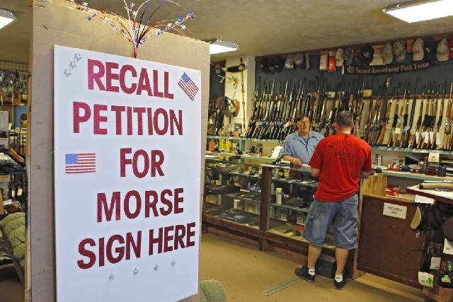 InA large sign posted at the entrance of Paradise Firearms in Colorado Springs, Colo., invites customers to sign a recall petition against Colorado Democratic State Senate President John Morse. In ...