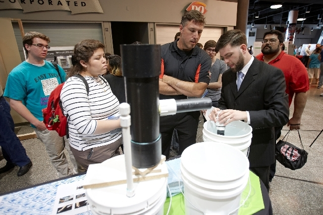 Eric Murphy, right, a senior at the University of Nevada, Las Vegas, was a member of the winning team during the UNLV Senior Design Competition May 9 at the Cox Pavilion. The team's project is set ...