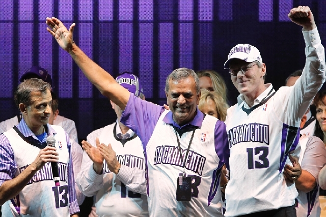 Vivek Ranadive, the new majority owner of the Sacramento Kings, left, introduces Kings investors Raj Bhathal, center and Paul Jacobs, to the crowd during the Long Live The Sacramento Kings rally i ...