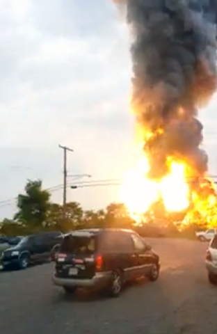 This still taken from video provided by James LeBrun shows an explosion outside Baltimore on Tuesday. Baltimore County fire officials say a train derailed in a Baltimore suburb on Tuesday and an e ...