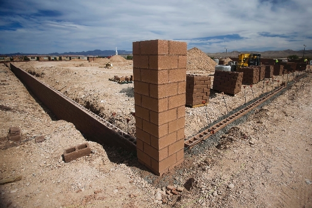 Construction is seen May 21 at Serenada community by Harmony Homes in Mountain's Edge. Home  prices there begin at more than $230,000. The Standard & Poor's/Case-Shiller home price index released  ...