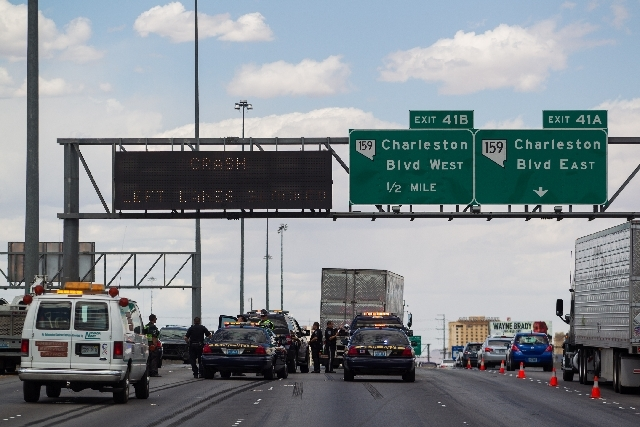 Nevada Highway Patrol officers investigate the scene of a five-vehicle crash including two semitrailers on the Interstate 15 northbound just past Sahara Avenue in Las Vegas on Tuesday.