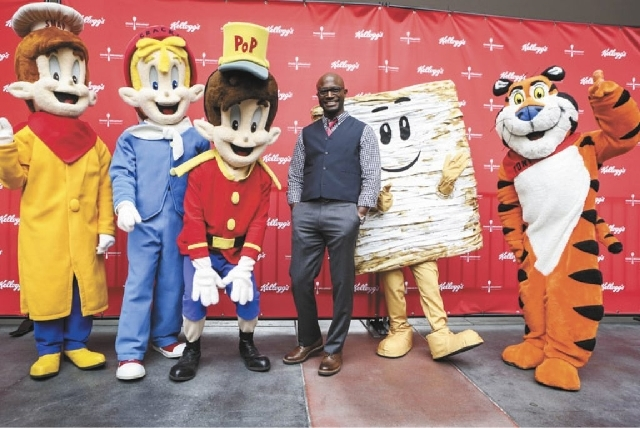 Actor Taye Diggs poses with Kellogg's Snap, Crackle, Pop, Mini, and Tony the Tiger during Kellogg's Share Breakfast event at Hollywood and Highland shopping center, Tuesday, March 5, in Los Angeles.