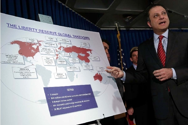 Preet Bharara, U.S. Attorney for the Southern District of New York, describes a chart showing the global interests of Liberty Reserve, during a news conference in New York on Tuesday. Arthur Budov ...