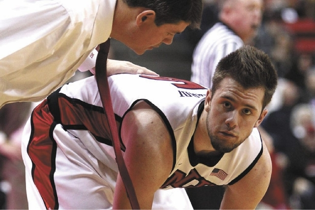 UNLV freshman guard Katin Reinhardt, shown with coach Dave Rice, had the second-most points and minutes on the Rebels in 2012-13, but that apparently wasn't enough.
