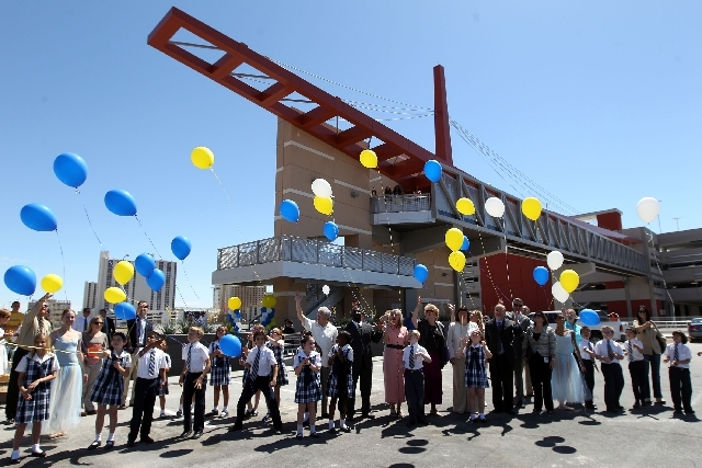 Second graders from Meadows School join Las Vegas Mayor Carolyn Goodman and other dignitaries as they release balloons to mark the official opening of the new pedestrian bridge between the City Ha ...
