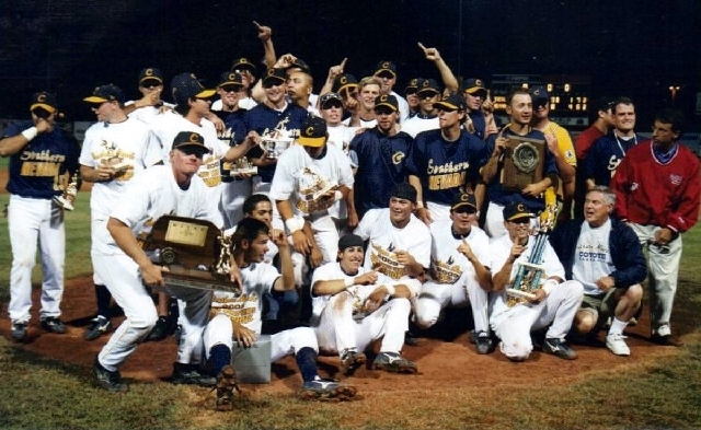 The College of Southern Nevada baseball team celebrates after winning the 2003 Junior College World Series in Grand Junction, Colo.