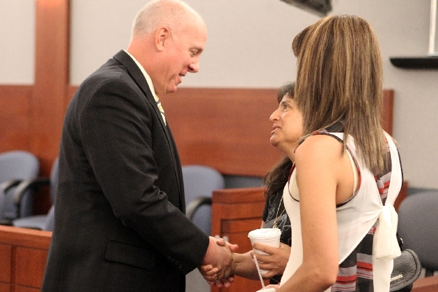 Chief Deputy District Attorney David Stanton congratulates Josefina Contreras, center, and Denise Espitia following the jury's verdict in the penalty phase of Gregory Hover's murder trial at the R ...