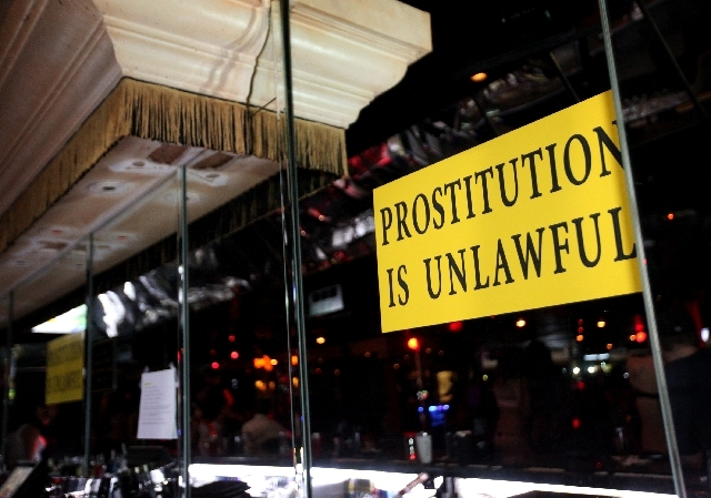"""A sign that reads """"PROSTITUTION IS UNLAWFUL"""" is seen at The Horse, the site of the former Crazy Horse Too, on Industrial Road in Las Vegas on Thursday, May 30, 2013. The strip club is set to hold  ..."""