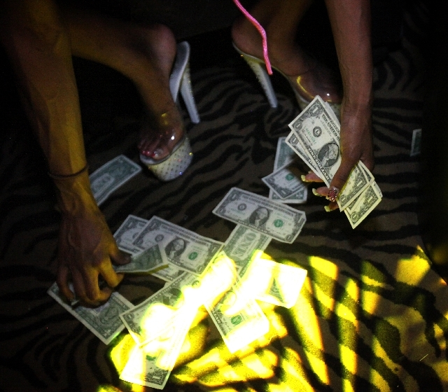 A dancer collects her tips at The Horse, the site of the former Crazy Horse Too, on Industrial Road in Las Vegas on Thursday, May 30, 2013. The strip club is set to hold a grand opening party Satu ...