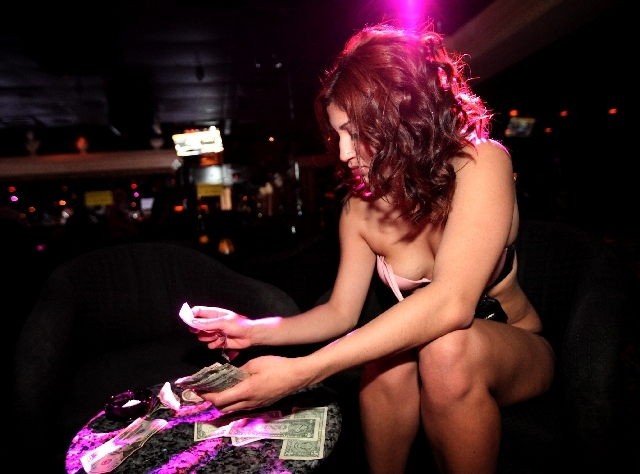 Veronica Cortez, who dances at The Horse, the site of the former Crazy Horse Too, on Industrial Road in Las Vegas collects tips after performing on stage on Thursday, May 30, 2013. The strip club  ...