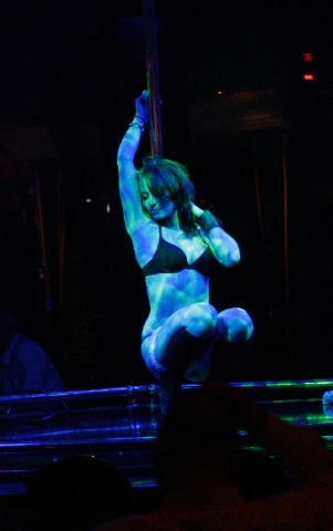 """A dancer who calls herself """"Hazel"""" performs at The Horse, the site of the former Crazy Horse Too, on Industrial Road in Las Vegas on Thursday, May 30, 2013. The strip club is set to hold a grand o ..."""