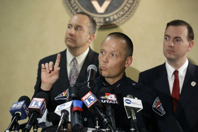 West Valley City, Utah, Deputy Police Chief Mike Powell, center, makes remarks during a Monday news conference. Citing a lack of leads, the police agency said it is closing the active investigatio ...