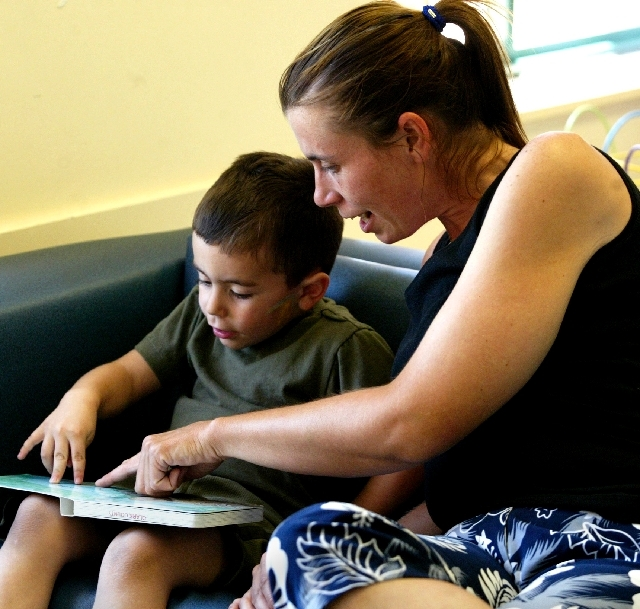 Tara Quintana reads with her son Jordan during a 2008 summer reading program kickoff event at the Clark County Library.