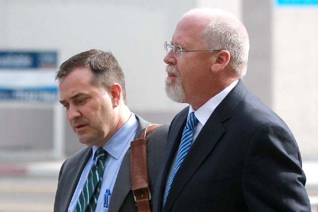 Harvey Whittemore, right, and his attorney John Arrascada walk from the federal courthouse in Reno, Nev., on Thursday, June 7, 2012.