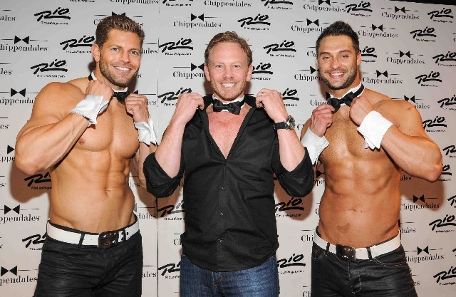 "Ian Ziering, who played Steve Sanders on ""90210,"" poses with two members of the Chippendales team. He hosts ""Chippendales"" at the Rio from June 6-30."
