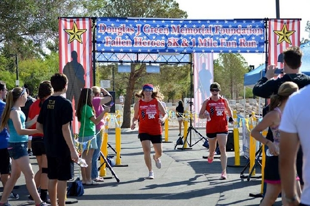 Rowena Hardin, left, and her daughter, LeAnna Marchese, hit the finish line May 18 for the Fallen Heroes event recognizing Armed Forces Day at Bruce Trent Park, 8851 Vegas Drive. The Douglas J. Gr ...