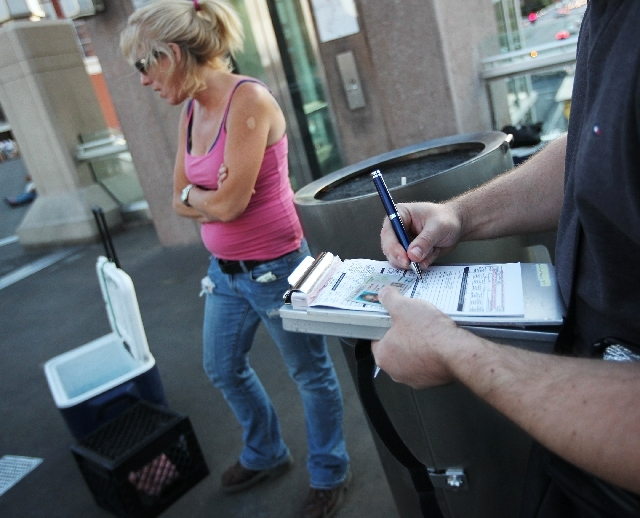 A woman from California is issued a citation by undercover agents with the Clark County Department of Business Licenses for illegally selling water on the Las Vegas Strip.