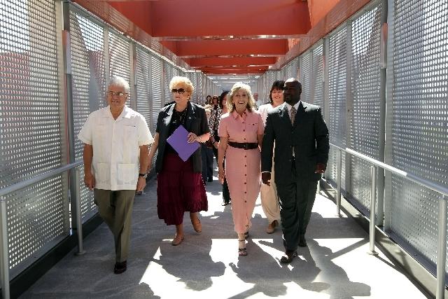 From left, Las Vegas City Councilman Bob Coffin, Las Vegas Mayor Carolyn Goodman, Rep. Dina Titus, D-Nev., and Councilman Ricki Barlow cross the new pedestrian bridge between the City Hall parking ...