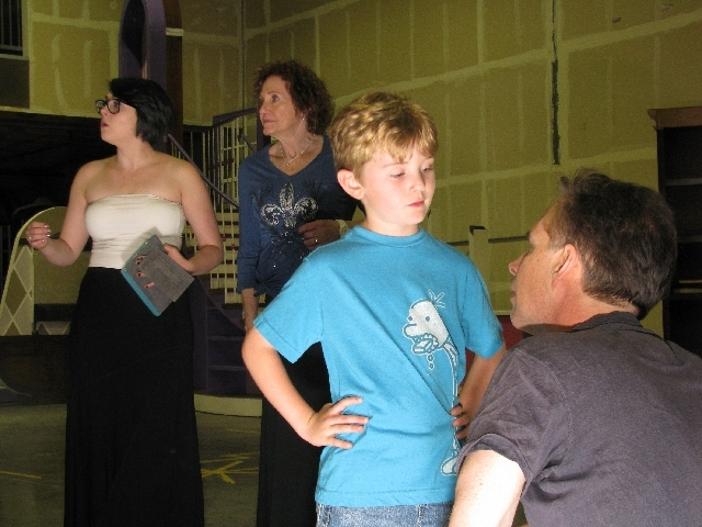 """Cast members of Huntsman Entertainment's production of Meredith Wilson's """"The Music Man,"""" from left, Tia Renee Konsu, James Horrocks, Gail Romero and Will Haley, rehearse in a warehouse space near ..."""