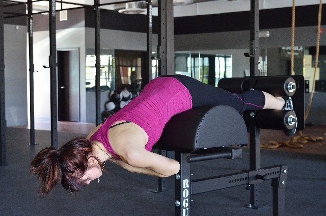 Back extensions, ACTION: Keeping the back and legs straight, hinge at the hip and push the butt backward. Allow the torso to lower to the front. Stop just before the back starts to round, then&nbs ...