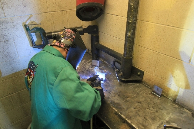 Sunrise-area Boy Scout Benjamin Bowen welds a project to complete his Boy Scouts of America welding merit badge at the Sheet Metal Workers Local No. 88 training center,  2560 Marco St. The local c ...