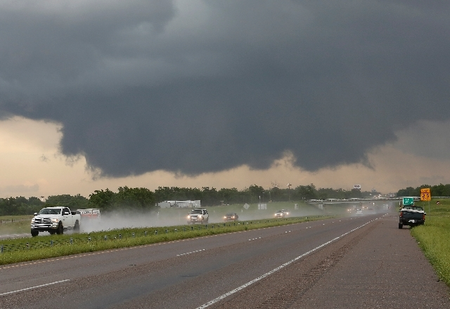 A wall cloud forms near Interstate 35 and Purcell, Okla. on Thursday.