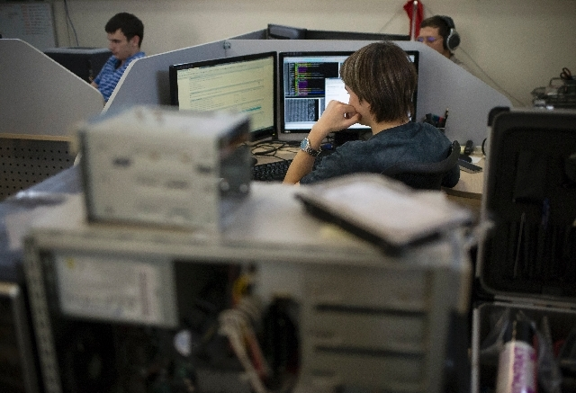 Employees of Moscow's Group-IB, which is responsible for one of Russia's two official Internet watchdogs, work in their laboratory in Moscow on Thursday.