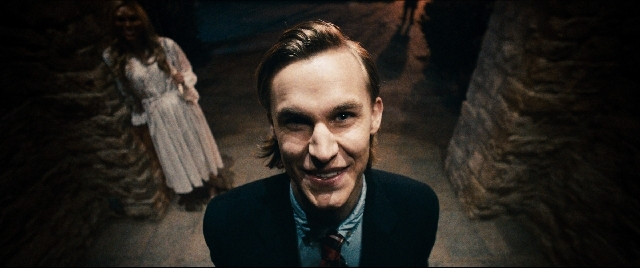 """The unnamed leader (Rhys Wakefield) of an upper-crust vigilante group terrorizes the Sandin family during a scene from """"The Purge."""""""