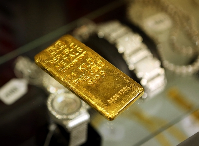 A one-kilo gold bar is on display at the U.S. Marshals Service National Forfeited Jewelry Auction preview on Friday in the Las Vegas Convention Center. The bar is expected to sell for $150,000. Ov ...