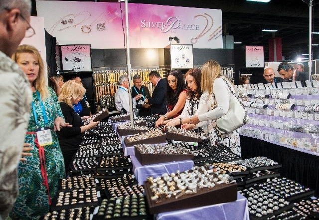 Attendees of the JCK trade show check out different grades of sterling silver at the Silver Palace booth Friday at the Mandalay Bay Convention Center. The event features 2,500 exhibitors from 22 c ...